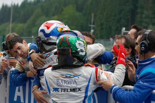 Spa - Francorchamps, Spa, Belgium. 29th August.Sunday Race.Sergio Perez (MEX, Barwa Addax Team) celebratrates his victory with team mate Giedo Van der Garde (NED, Barwa Addax Team) and the rest of the team. Photo: Charles Coates/GP2 Media Service.Ref: __26Y5727 jpg