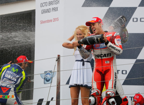 2015 MotoGP Championship.  British Grand Prix.  Silverstone, England. 28th - 30th August 2015.  Danilo Petrucci, Pramac Ducati, 2nd position, Valentino Rossi, Yamaha, 1st position, and Andrea Dovizioso, Ducati, 3rd position, celebrate on the podium.  Ref: KW5_5606a. World copyright: Kevin Wood/LAT Photographic