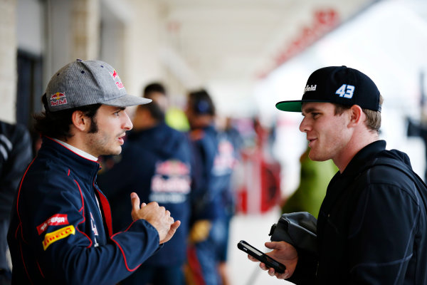 Circuit of the Americas, Austin, Texas, United States of America. Saturday 24 October 2015. Carlos Sainz Jr, Toro Rosso, and Conor Daly, Schmidt Peterson Motorsports, IndyCar. World Copyright: Glenn Dunbar/LAT Photographic. ref: Digital Image _89P4804
