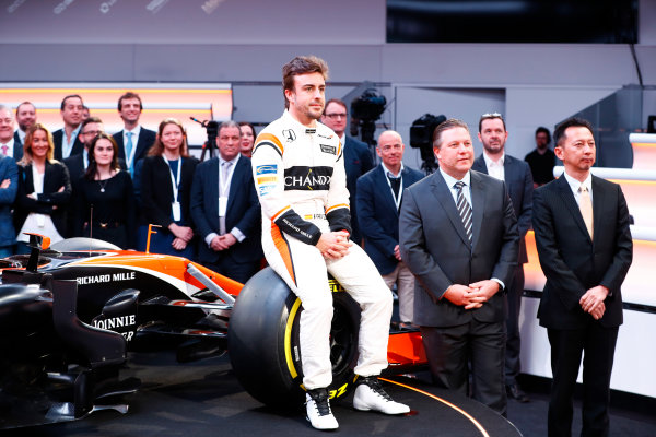McLaren MCL32 Honda Formula 1 Launch. McLaren Technology Centre, Woking, UK. Friday 24 February 2017. Fernando Alonso, McLaren, sits on a front wheel of the MCL32, alongside Zak Brown, Executive Director of McLaren Technology Group, and Yusuke Hasegawa, Senior Managing Officer, Honda.  World Copyright: Steven Tee/LAT Images Ref: _O3I5031