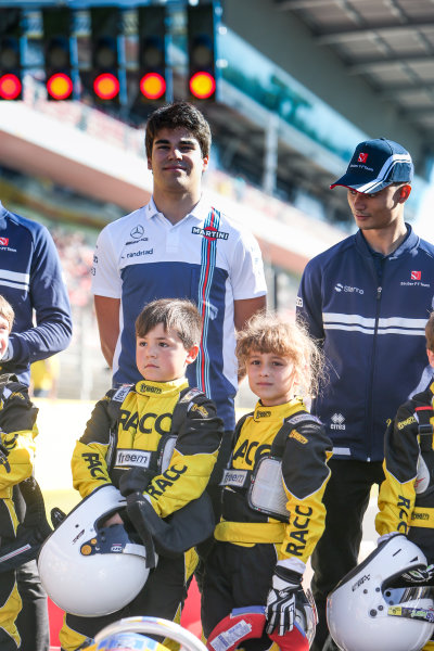 Circuit de Catalunya, Barcelona, Spain. Thursday 11 May 2017. Lance Stroll, Williams Martini Racing, and Pascal Wehrlein, Sauber, with some junior Kart racers. World Copyright: Dom Romney/LAT Images ref: Digital Image GT2R9754