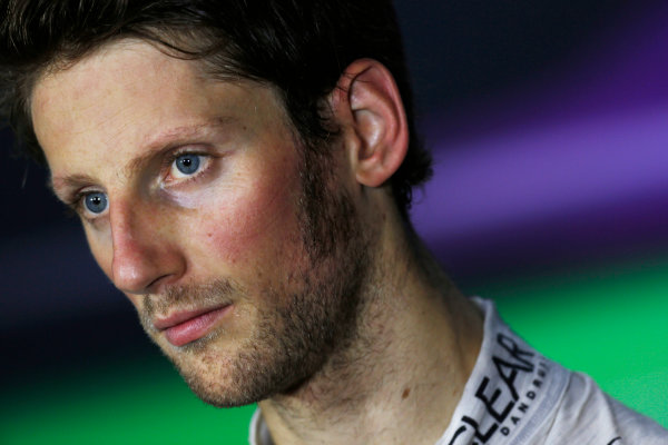 Marina Bay Circuit, Singapore. Saturday 21st September 2013.  Romain Grosjean, Lotus F1, in the press conference after qualifying.  World Copyright: Charles Coates/LAT Photographic. ref: Digital Image _N7T5457