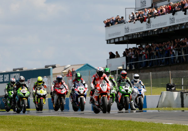 2014 World Superbike Championship  Donington Park, UK.  24 - 25th May 2014.  Riders come to the grid ready for the start of race 2.  Ref: _W5_8905a. World copyright: Kevin Wood/LAT Photographic