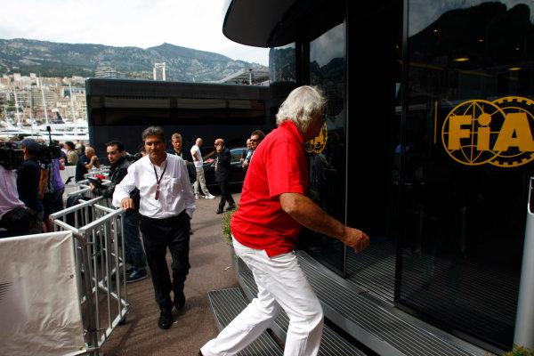 Monte Carlo, Monaco15th May 2010Flavio Braitore enters the FIA motorhome. Portrait. World Copyright: Charles Coates/LAT Photographicref: Digital Image _26Y8935