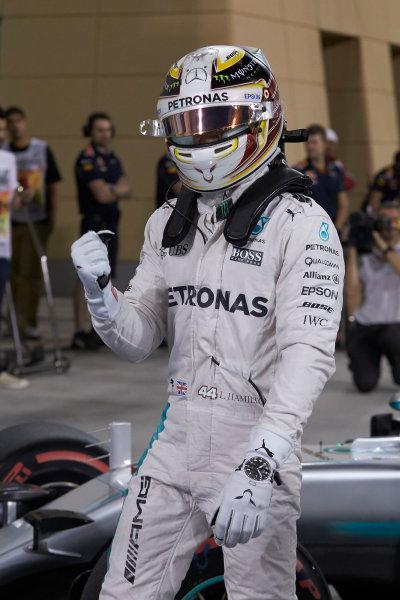Bahrain International Circuit, Sakhir, Bahrain. Saturday 2 April 2016. Lewis Hamilton, Mercedes AMG, celebrates pole in Parc Ferme. World Copyright: Steve Etherington/LAT Photographic ref: Digital Image SNE25198
