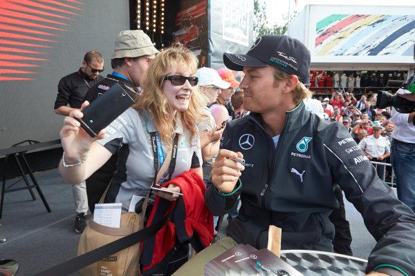 Red Bull Ring, Spielberg, Austria. Saturday 21 June 2014. Nico Rosberg, Mercedes AMG, meets a fan. World Copyright: Steve Etherington/LAT Photographic. ref: Digital Image SNE25361 copy