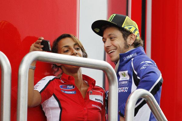 2014 MotoGP Championship  British Grand Prix.  Silverstone, England. 29th - 30st August 2014.  Valentino Rossi, Yamaha, visits the Ducati motorhome.  Ref: _W1_7662. World copyright: Kevin Wood/LAT Photographic