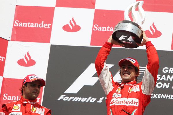 Race winner Fernando Alonso (ESP) Ferrari celebrates on the podium (Right) alongside second placed team mate Felipe Massa (BRA) Ferrari. Formula One World Championship, Rd 11, German Grand Prix, Race, Hockenheim, Germany, Sunday 25 July 2010.  BEST IMAGE