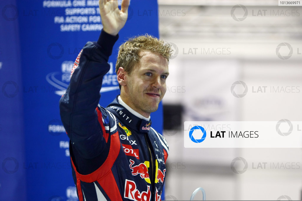 Marina Bay Circuit, Singapore.24th September 2011.Sebastian Vettel, Red Bull Racing RB7 Renault, celebrates pole. Portrait. World Copyright: Andy Hone/LAT Photographicref: Digital Image CSP28607