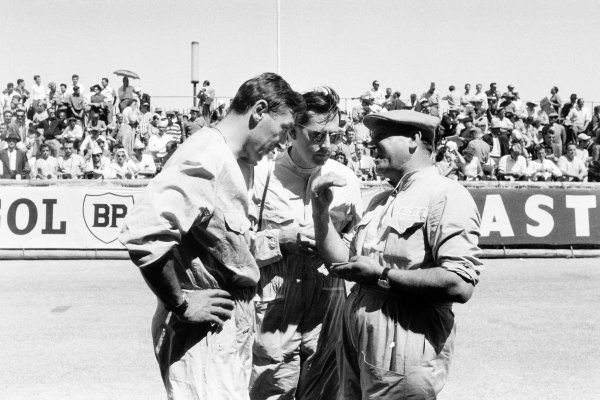 1958 Monaco Grand Prix.Monte Carlo, Monaco. 18 May 1958.Roy Salvadori, Cooper T45-Climax, retired, and Jack Brabham, Cooper T45-Climax, 4th position, talk to a mechanic, portrait.World Copyright: LAT PhotographicRef: Autosport b&w print
