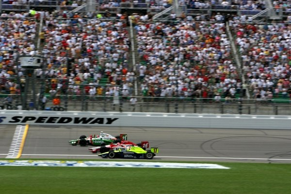First to third place finishers: Tony Kanaan (BRA), Andretti Green Racing Dallara Honda, Dan Wheldon (GBR), Andretti Green Racing Dallara Honda, and Vitor Meira (BRA), Rahal Letterman Racing Panoz Honda, take the checkered flag at the Argent Mortgage 300. It was the sixth closest finish in IRL history.IRL IndyCar Series, Rd8, Argent Mortgage Indy 300, Kansas Speedway, Kansas, USA. 3 July 2005.DIGITAL IMAGE