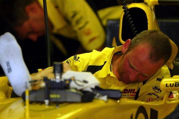 A Jordan Honda mechanic find the cockpit a tight squeeze.Formula One Testing, Barcelona, Spain, 25 June 2002.