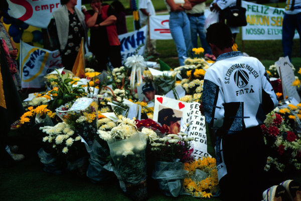 1995 Brazilian Grand Prix.Interlagos, Sao Paulo, Brazil.24-26 March 1995.A huge pile of flowers forms at the track to commemorate the death of Ayrton Senna, this being the first Brazilian Grand Prix since his death.World Copyright - LAT Photographic