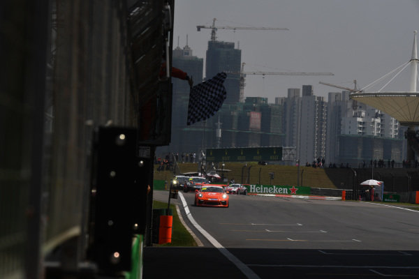 Race winner Philip Hamprecht (GER) Team StarChase takes the chequered flag  t Porsche Carrera Cup Asia, Shanghai, China, 13-15 April 2018.
