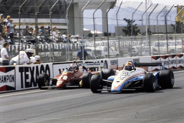 Eddie Cheever, Ligier JS19 Matra, battles with Mario Andretti, Ferrari 126C2.