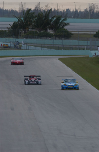 2002 Grand Am @ Homestead, Homestead, Florida, USAFeb 28-March 2, 2002From a tv tower above we look down on the inside straight of Homestead with the turn one of the oval in the background. A GT Porsche leads a SRPII and the GT Ferrari.C: Douglas Phillips, USALAT Photographic