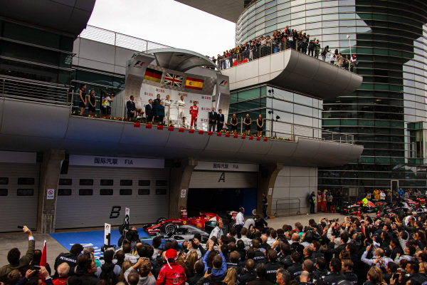 Lewis Hamilton, 1st position, Nico Rosberg, 2nd positon, and Fernando Alonso, 3rd position, on the podium.