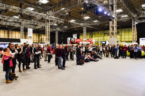 Visitors listen to Sarah Moore, Esmee Hawkley and David Coulthard talk about W Series on stage