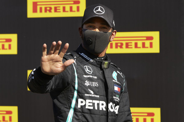 Lewis Hamilton, Mercedes-AMG Petronas F1, waves to the camera after securing pole