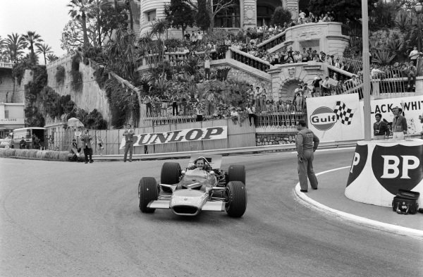 Graham Hill, Lotus 49B Ford, celebrates victory after the race.