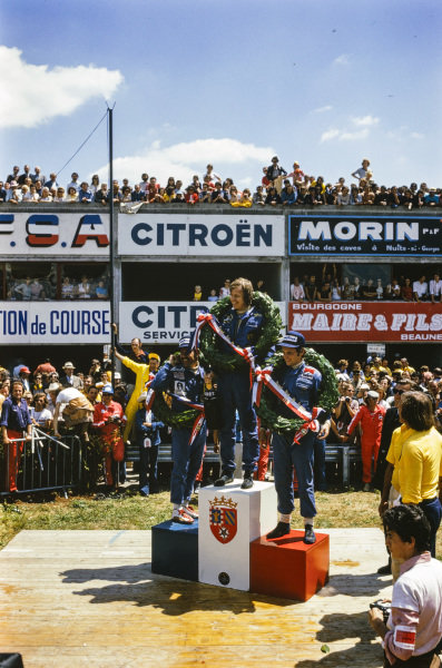 Ronnie Peterson celebrates victory with Niki Lauda, 2nd position, and Clay Regazzoni, 3rd position.