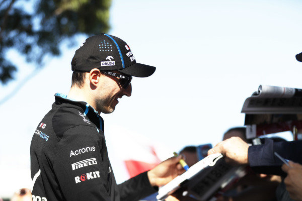 Robert Kubica, Williams Racing, signs autographs for fans.