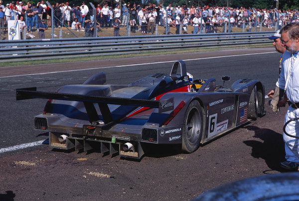 2002 Le Mans 24hr, La Sarthe, France, 15 -16 June 2002. An excursion into the gravel for the Cadillac of Taylor, Angelli and Tinseau delays them temporarily early in the race. They recover to finish 9th on 345 laps. World Copyright: LAT Photographic Ref: 02LM32.