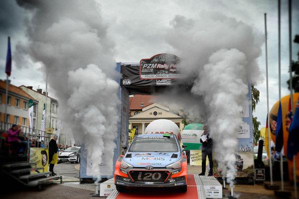 Third placed Hayden Paddon (NZL) / John Kennard (NZL), Hyundai Motosport New Generation i20 WRC celebrate on the podium at FIA World Rally Championship, Rd7, Rally Poland, Day Three, Mikolajki, Poland, 3 July 2016.
