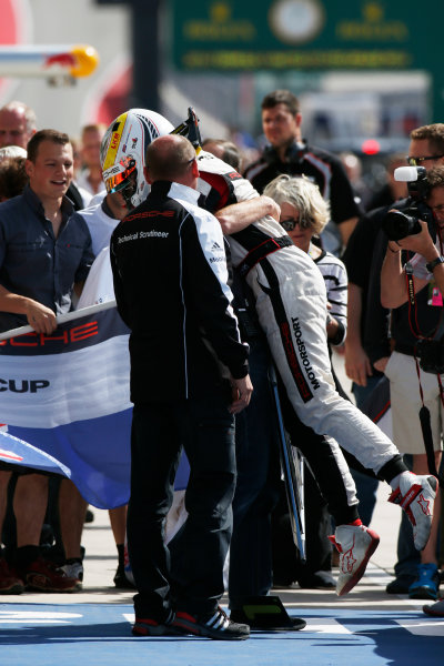 2014 Porsche Supercup. Sunday 2 November 2014. Earl Bamber, No.19 Fach Auto Tech, celebrates championship victory. World Copyright: /LAT Photographic. ref: Digital Image _W2Q7119