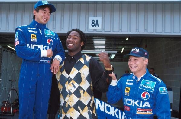Ukyo Katayama, left and Mika Salo meet British Boxer Lennox Lewis.