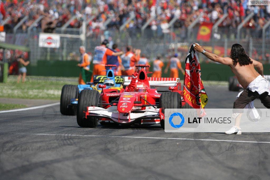 2006 San Marino Grand Prix - Sunday Race Imola, Italy. 20th - 23rd April 2006 Michael Schumacher, Ferrari 248F1, 1st position, leads Fernando Alonso, Renault R26, 2nd position, after the finish, celebration, action. World Copyright: Lorenzo Bellanca/LAT Photographic ref: Digital Image ZD2J7889