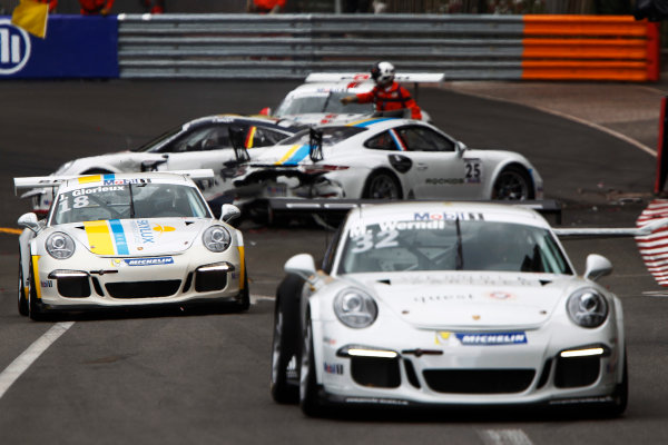 Porsche Supercup Round 2 Monte Carlo, Monaco. Sunday 24 May 2015. Maximillian Werndl, No.32 VERVA Lechner Racing Team, leads Jean Glorieux, No.18 Speed Lover & Allure, past the crash of Carlos Rivas, No.25 Speed Lover & Allure, Patrick Eisemann, No.8 F?rch Racing by Lukas MS, and Chris Bauer, No.9 F?rch Racing by Lukas MS. World Copyright: Sam Bloxham/LAT Photographic. ref: Digital Image _G7C9247