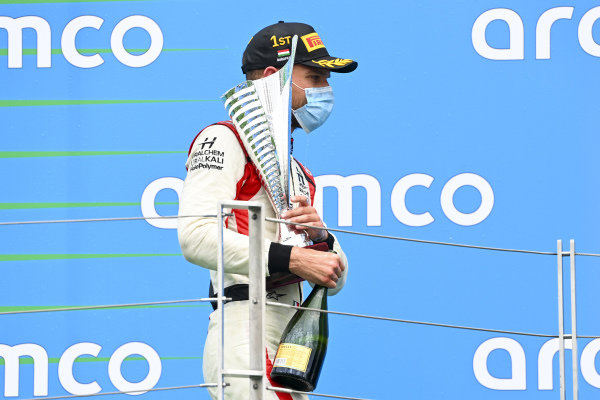 Luca Ghiotto (ITA, HITECH GRAND PRIX) on the podium with the trophy and the champagne