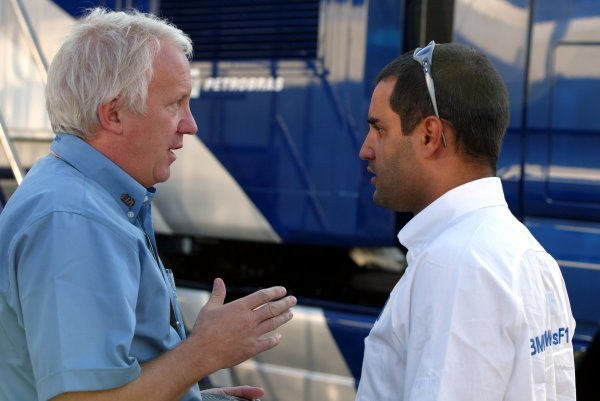 (L to R): Charlie Whiting (GBR) FIA Race Director and Safety Delegate talks with Juan Pablo Montoya (COL) Williams.Formula One World Championship, Rd4, San Marino Grand Prix, Practice Day, Imola, Italy, 23 April 2004.DIGITAL IMAGE