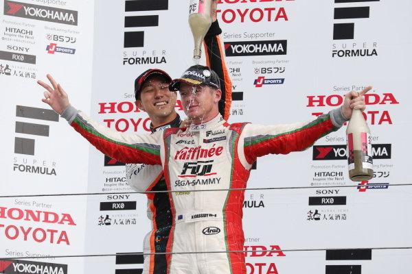 Winner Nick Cassidy, number three ORIENTALBIO KONDO SF14 Toyota, celebrates on the podium.