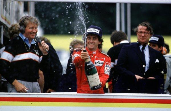 1985 European Grand Prix.Brands Hatch, Great Britain.4-6 October 1985.Alain Prost (McLaren TAG Porsche) 4th position, celebrates clinching the World Championship.  Ref: 85EUR02. World Copyright - LAT Photographic