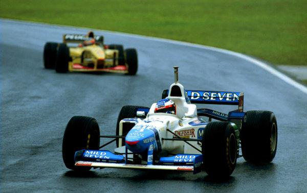 1996 Brazilian Grand Prix.Interlagos, Sao Paulo, Brazil.29-31 March 1996.Jean Alesi (Benetton B196 Renault) leads Rubens Barrichello (Jordan 196 Peugeot). Alesi finished in 2nd position.World Copyright - LAT Photographic