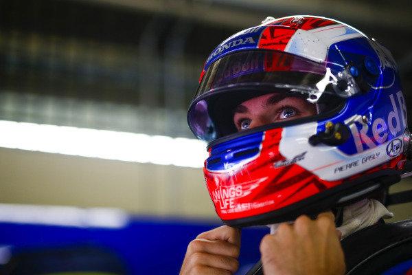 Pierre Gasly, Toro Rosso, adjusts his helmet.