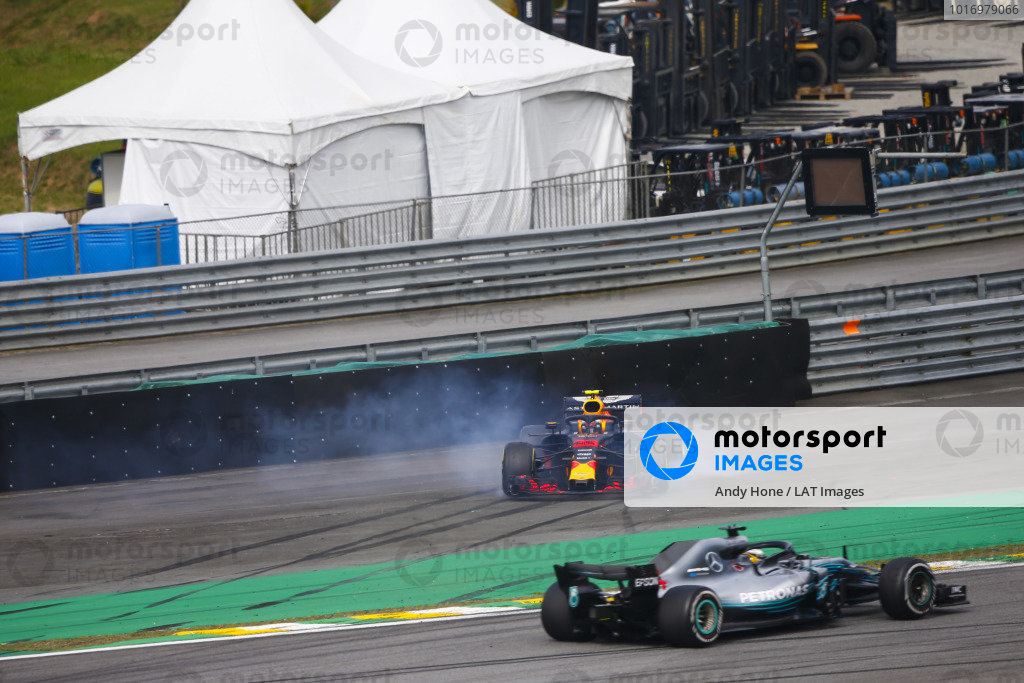 Lewis Hamilton, Mercedes AMG F1 W09, passes a spinning Max Verstappen, Red Bull Racing RB14 Tag Heuer, after the latter suffers a collision with Esteban Ocon, Force India VJM11 Mercedes.