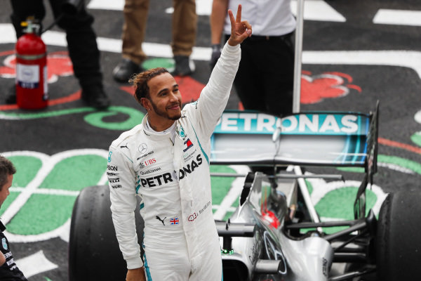 Lewis Hamilton, Mercedes AMG F1, celebrates after securing his 5th world drivers title