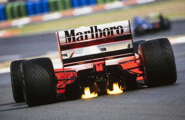 Plumes of fire from Ayrton Senna, McLaren MP4-7A Honda.