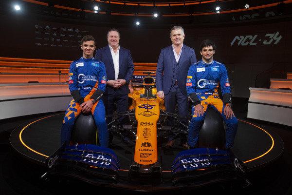 (L to R): Lando Norris, McLaren, Zak Brown, McLaren Racing CEO, Gil De Ferran, McLaren Sporting Director and Carlos Sainz Jr, McLaren with the new McLaren MCL34