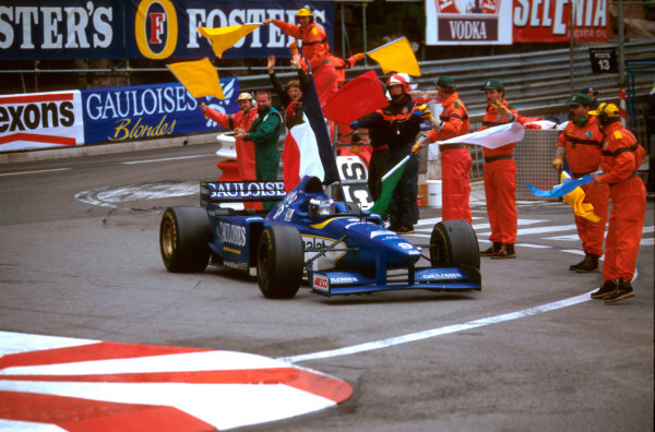 Monte Carlo, Monaco.16-19 May 1996.Olivier Panis (Ligier JS43 Mugen-Honda) 1st position drives around the streets with the tricolour.Ref-96 MON 05.World Copyright - LAT Photographic