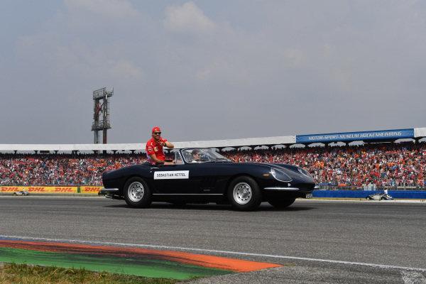 Sebastian Vettel (GER) Ferrari on the drivers parade