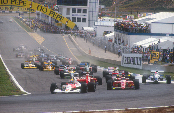 1990 Spanish Grand Prix.Jerez, Spain.28-30 September 1990.Ayrton Senna (McLaren MP4/5B Honda) leads Alain Prost, Nigel Mansell (both Ferrari 641's), Gerhard Berger (McLaren MP4/5B Honda), Riccardo Patrese, Thierry Boutsen (both Williams FW13B Renault's), Alessandro Nannini and Nelson Piquet (both Benetton B190 Ford's) at the start. Jean Alesi (Tyrrell 019 Ford) spins out at the first corner with a punctured left rear tyre after contact with Berger.Ref-90 ESP 16.World Copyright - LAT Photographic