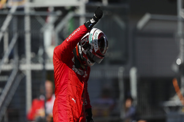 Charles Leclerc, Ferrari, celebrates pole on the grid after Qualifying