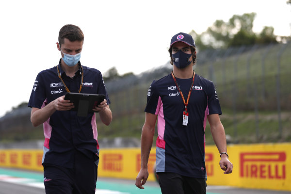 Lance Stroll, Racing Point, walks the circuit with colleagues