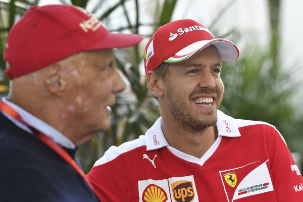 Niki Lauda (AUT) Mercedes AMG F1 Non-Executive Chairman and Sebastian Vettel (GER) Ferrari at Formula One World Championship, Rd18, United States Grand Prix, Qualifying, Circuit of the Americas, Austin, Texas, USA, Saturday 22 October 2016.