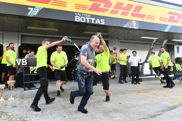 The Mercedes team celebrates victory