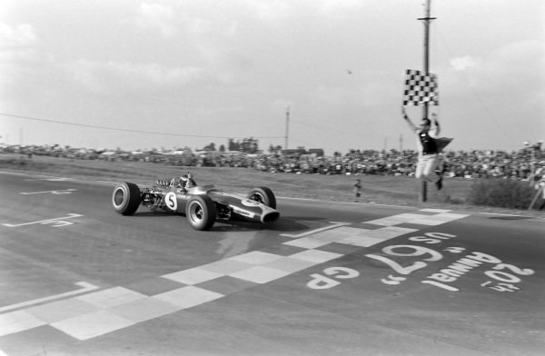 Jim Clark, Lotus 49 Ford, takes the chequered flag for victory.